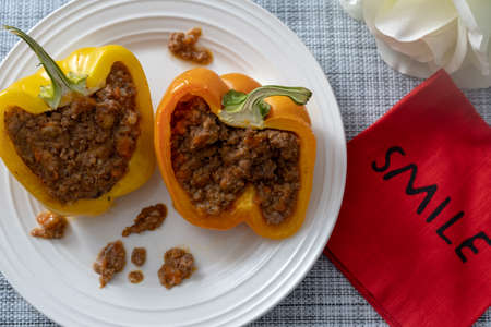 2019-03-09 - Beef stuffed bell peppers with a Smile napkin and a white rose