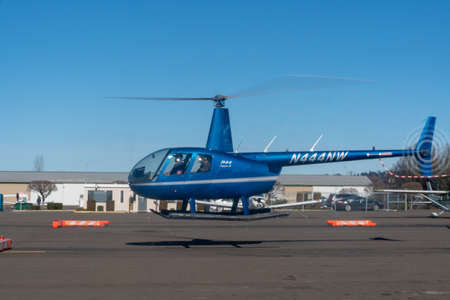 Kent, Washington - 2019-03-03 - Blue R44 before landing Редакционное
