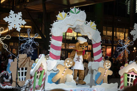 Bellevue, Washington - 2018-11-25 - Bear with gingerbread man cookies at the Bellevue Christmas Parade