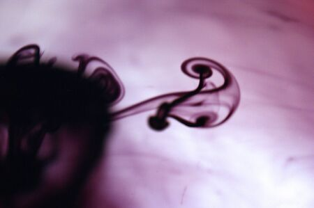 purple ink in water abstraction background violet swirly