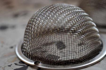 tea infuser zoom strainer infusing tea metal closeup