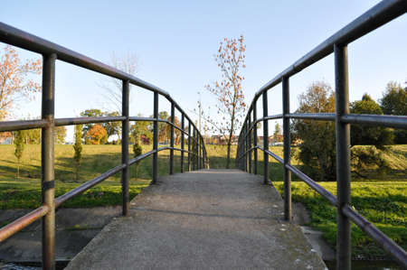 bridge over the river stream footbridge metal railings