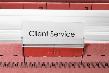 client service: red hanging file folder labeled with client service