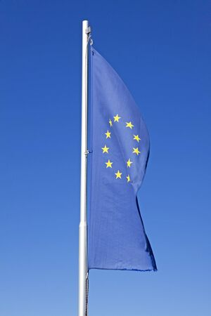 european flag waving on a pole photo