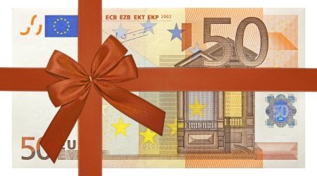 christmas bonus: fifty euro bank note with red ribbon band