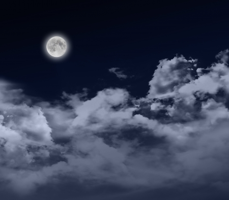 glowing full moon at night with cloudscape Stock Photo