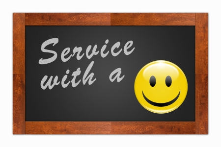 customer service phone: Service with a Smile written with chalk on a wooden frame blackboard Stock Photo