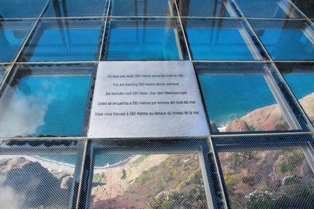 steep cliffs sign: Skywalk at Cabo Girao, Madeira. View down to the atlantic ocean. Stock Photo