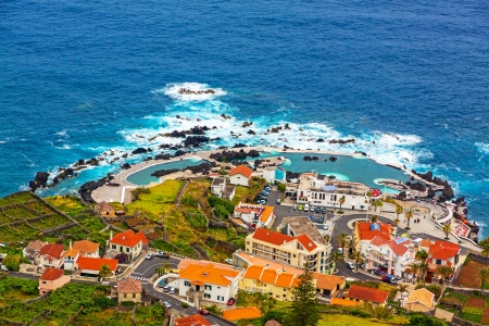 View of the village of Porto Moniz with lava-rock pool, Madeira Island, Portugal