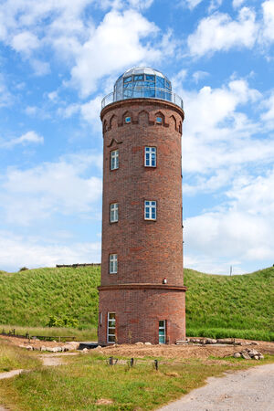 kap: Peilturm at Kap Arkona, Island of Ruegen, Germany, green field Stock Photo