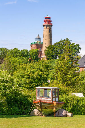 kap: Lighthouse at Kap Arkona with old boat in front, Island of Ruegen, Germany
