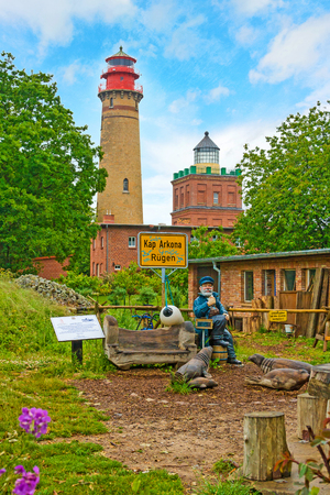 kap: Putgarten, Germany - June 22, 2012: Lighthouse at Kap Arkona with captain sculture. A famous tourist destination on the island of rugia. Editorial