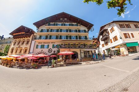 wolfgang: St. Wolfgang, Austria - June 23, 2014: Hotel Schwarzes Roessl at the famous lake Wolfgangsee. Popular travel destination within Austria.