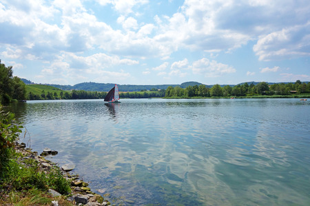 catchment: Lake Breitenau near Obersulm, Baden-Wuerttemberg, Germany - with sailing boat