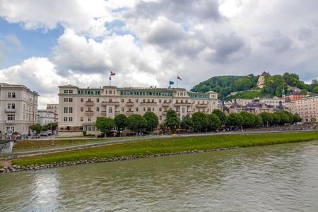 salzach: Salzburg, Austria - June 25, 2014: Famous Hotel Sacher Salzburg, near the river Salzach.