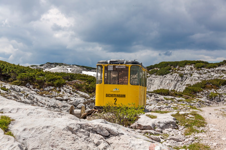 ropeway: Obertraun, Austria - June 27, 2014: Ropeway gondola at Dachstein mountains, a famous tourist destination of Salzburger Land for hikers. Editorial