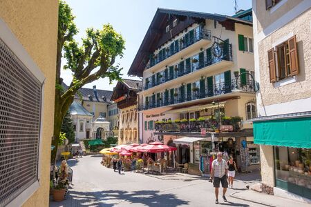 accomodation: St. Wolfgang, Austria - June 23, 2014: Hotel Schwarzes Roessl at the famous lake Wolfgangsee. Popular travel destination within Austria.