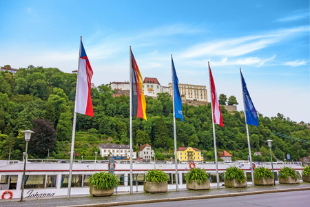tourist spot: Passau, Germany - June 29, 2014: Veste Oberhaus, historical stronghold of the old historical city of Passau, a famous tourist spot - view from town hall near the river Donau Editorial