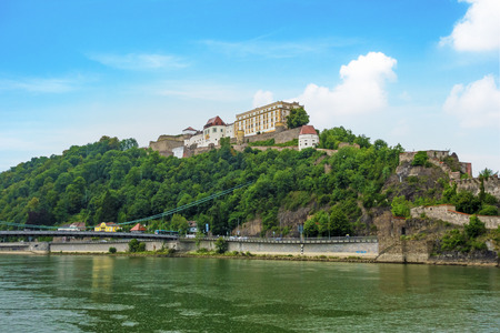 tourist spot: Veste Oberhaus, historical stronghold of the old historical city of Passau, a famous tourist spot - view from town hall near the river Donau