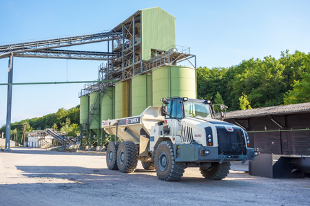 aggregates: Hagenbach, Germany - May 31, 2014: Large Volvo Terex Truck TA 250 in open pit mining and processing plant for crushed stone, sand and gravel at polder Daxlander Au