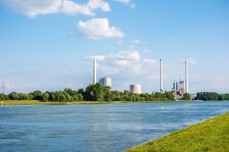 karlsruhe: Karlsruhe, Germany - May 31, 2014: Steam power plant and hard coal-fired power station Rheinhafen-Dampfkraftwerk Karlsruhe EnBW, river Rhine in foreground.