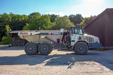 oversize load: Hagenbach, Germany - May 31, 2014: Large Volvo Terex Truck TA 250 in open pit mining and processing plant for crushed stone, sand and gravel at polder Daxlander Au