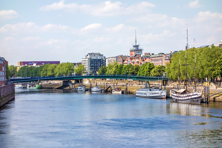 river: Bremen, Germany - June 6, 2014: Cityscape along the Weser river in Bremen, Germany