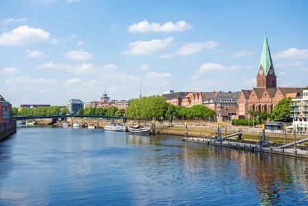 Bremen, Germany - June 6, 2014: Cityscape along the Weser river in Bremen, Germany