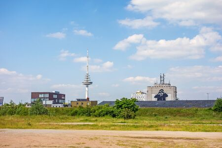 noticeable: Bremen, Germany - June 6, 2014: Communication  television tower Waller-Spargel with noticeable building (man with binoculars) in district Walle Editorial