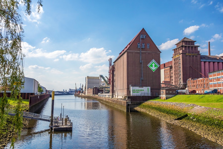 west river: Bremen, Germany - June 6, 2014: Anabranch of Weser river with old brick buildings in Bremen-Walle in the west of the city - farina producer Rolandm�hle on the right Editorial