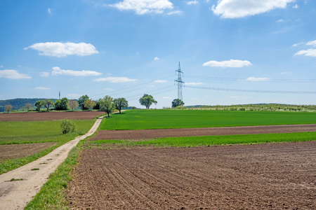 cropland: country lane through farmland, ploughed field, trees aside