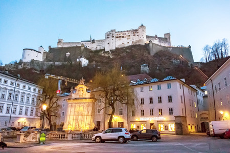 amadeus: Salzburg, Austria - December 31, 2013: Famous Hohensalzburg Fortress - view from Kapitelplatz square at evening.