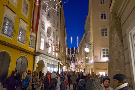 amadeus: Salzburg, Austria - December 31, 2013: Street Getreidegasse, at the birth house of Wolfgang Amadeus Mozart by night on New Years Eve