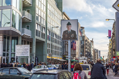 west of germany: Berlin, Germany - October 26, 2013: Checkpoint Charlie streetview - it was the most famous crossing point between East and West Germany during the cold war.
