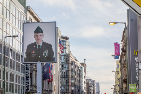 west germany: Berlin, Germany - October 26, 2013: Checkpoint Charlie streetview - it was the most famous crossing point between East and West Germany during the cold war.