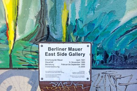 Berlin, Germany - October 26, 2013: East Side Gallery - an international memorial for freedom. Former Berlin Wall - a barrier within Germany, dividing the country.