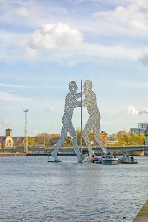 treptow: Berlin, Germany - October 29, 2013: Molecule Man sculpture by Jonathan Borofsky. The sculpture represent the intersection of the districts Treptow, Kreuzberg and Friedrichshain.