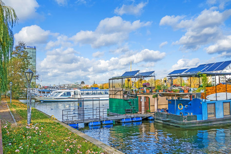 treptow: Berlin, Germany - October 29, 2013: River spree in the district  Treptow. House boats and swimming gardens riverside.