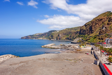 ribeira: Ribeira Brava, Portugal - June 1, 2013: At the southern end of Ribeira Brava - view of the coastline with beach.