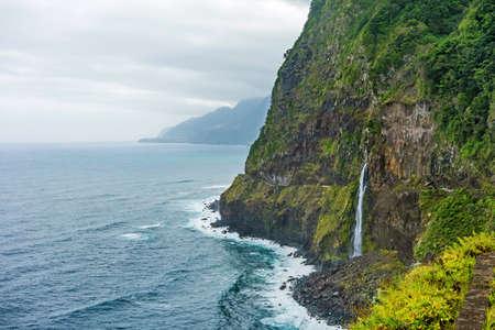 coastlines: Wild atlantic coast, Island Madeira coastline - impressiv mountain with waterfall - Ponta do Poiso Stock Photo