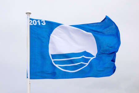 sightseers: Waving blue flag. The flag stands for the best beaches in Europe 2013