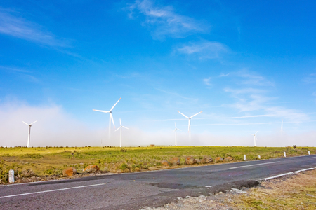paisaje natural: wind turbines along road - natural landscape Foto de archivo
