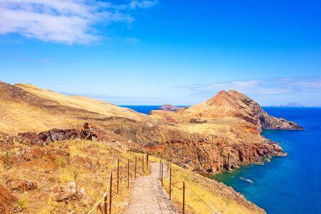 mountainous: Mountainous landscape - peninsula Ponta de Sao Lourenco - east of Madeira. Hiking trail in front.