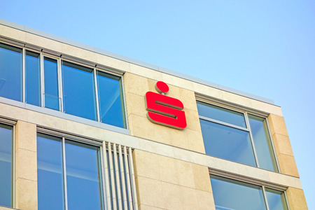 economizing: Stuttgart, Germany - November 1, 2013: Modern building facade with logo of the german banks named Sparkasse. The sign is famous symbol of recognition of the savings banks in Germany. Editorial