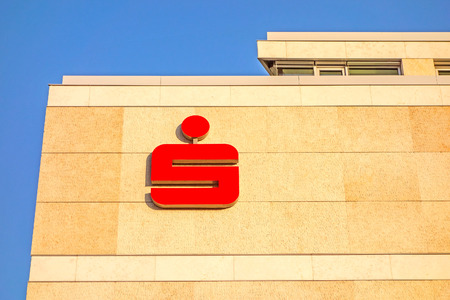 Stuttgart, Germany - November 1, 2013: Modern building facade with logo of the german banks named Sparkasse. The sign is famous symbol of recognition of the savings banks in Germany. Éditoriale
