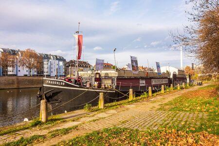 Stuttgart, Germany - November 14, 2015: Showboat Theaterschiff Stuttgart  Frauenlob riversides at the river Neckar near the center of district Bad Cannstatt.