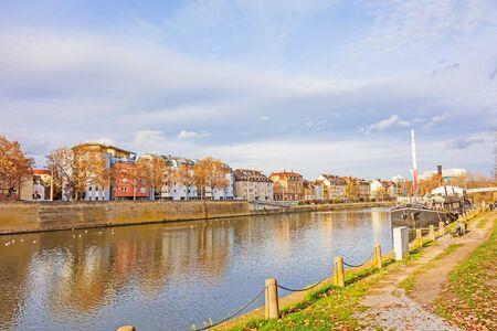 Stuttgart, Germany - November 14, 2015: River Neckar near the center of district Bad Cannstatt - road towards named Neckartalstrasse, showboat Theaterschiff Stuttgart  Frauenlob on the right. Editorial