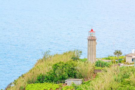 jorge: Sao Jorge, Madeira - June 7, 2013: Lighthouse Ponta de Sao Jorge - a famous tourist sight at the north coast of Madeira.