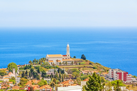 residencial: Funchal, Madeira - June 7, 2013: Church of Sao Martinho - a civil parish in the municipality of Funchal. View from Pico dos Barcelo - south coast of Madeira - Atlantic Ocean in the background. Editorial