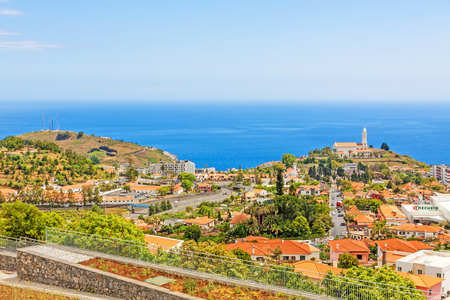 residencial: Funchal, Madeira - June 7, 2013: South coast of Funchal -view over the capital city of Madeira, district Sao Martinho with civila parish church. View from Pico dos Barcelo - Atlantic Ocean in the background. Stock Photo